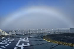 a rainbow in the fog